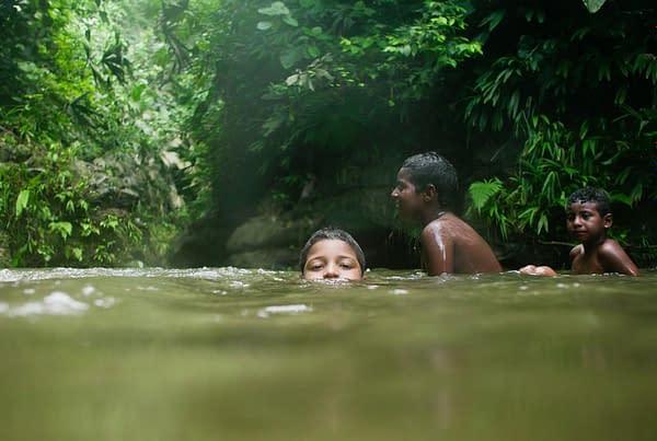 Boys in the jungle lake